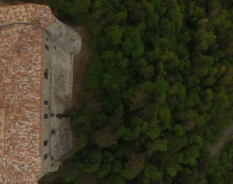 vertical photography of Montebello Castle in Valmarecchia